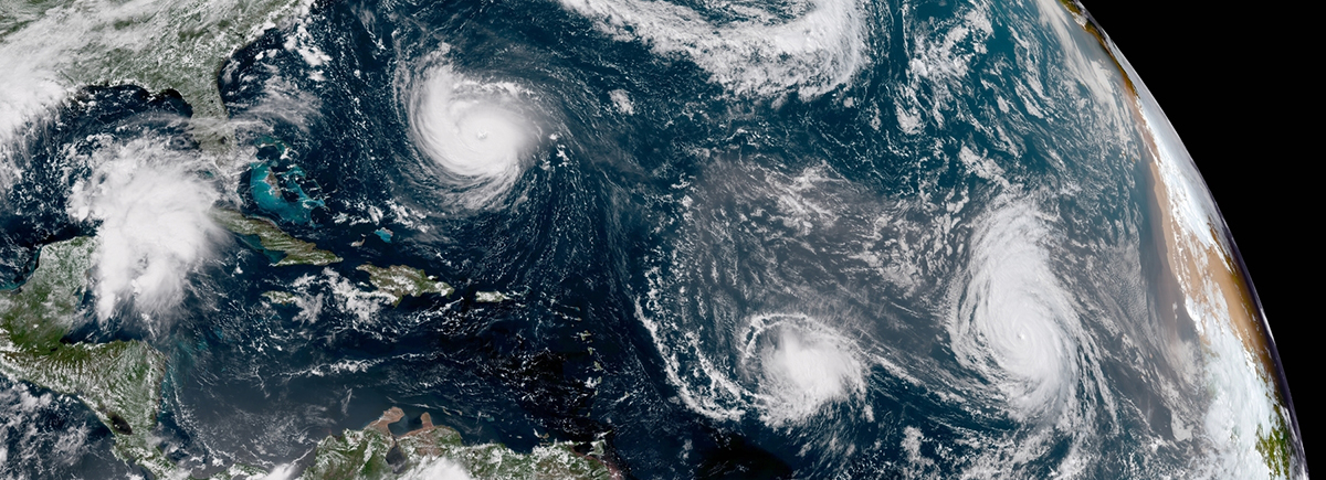 GOES East GeoColor satellite image of the Atlantic Ocean on September 11, 2018 showing Hurricanes Florence (L) and Helene (R) and Tropical Storm Isaac (center). Photo Credit: NOAA/NESDIS