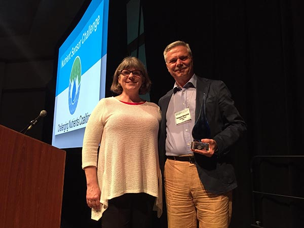 Denice Shaw of the EPA Office of Research and Development present the award to Pompeo Moscetta of Systea at the ASLO conference in Honolulu.