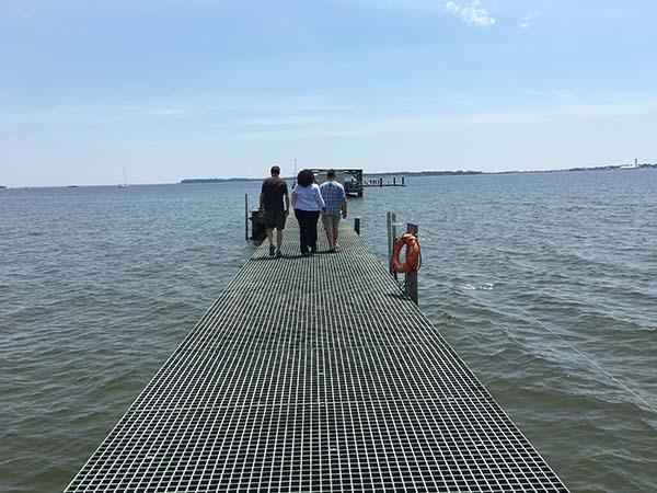 IOOSians Deputy Director Carl Gouldman, Grants Officer Regina Evans, and LCDR Eric Johnson walk out to the sampling example location at end of the pier.