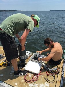 Assembling the NOC experiment electronics on the pier.