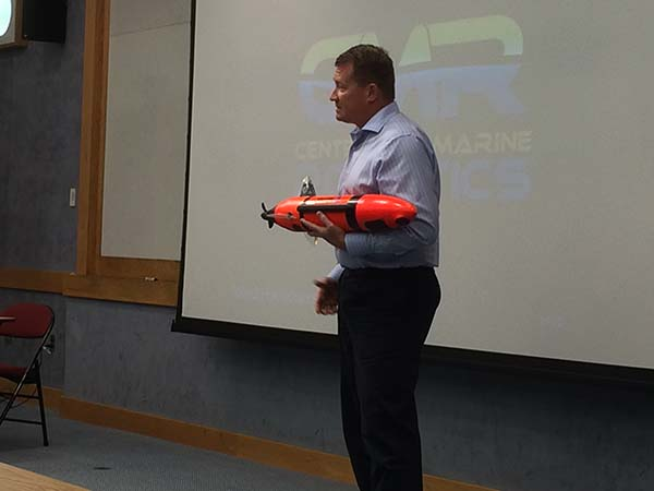 Jeff Smith, Riptide Autonomous Systems, holds their innovative, low-cost AUV.