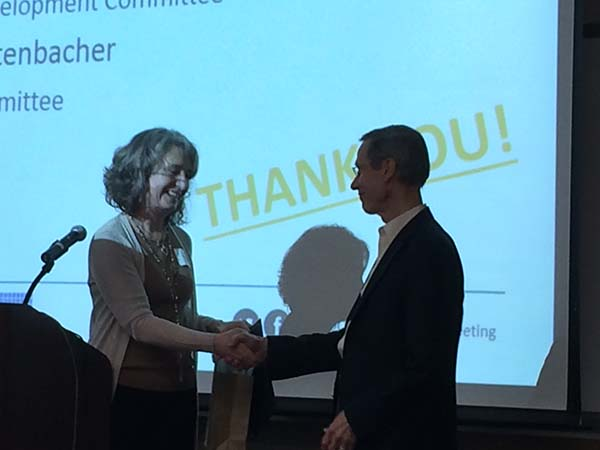 Debra Hernandez shakes hands with Conrad Lautenbacher