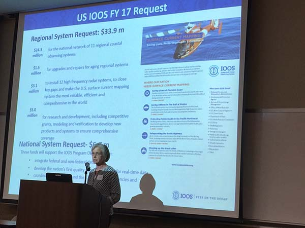 Josie Quintrell speaks in front of a powepoint slide on FY17 funding requests