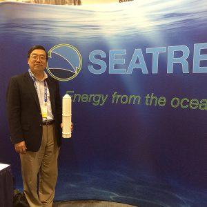 Yi Chao standing by Searec drop