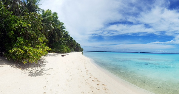 shallow blue water along a white sand beach